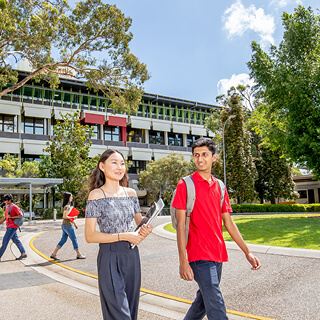 Two Griffith College students walking together on campus