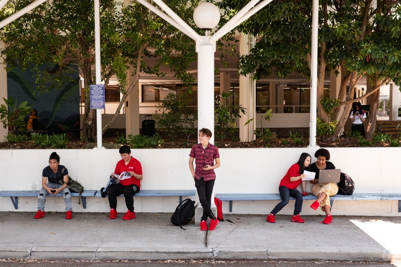 Group of Griffith College students waiting at bus stop