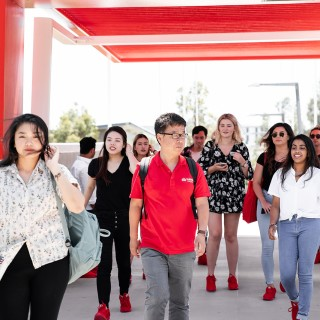 Group of Griffith College students walking on Griffith bridge