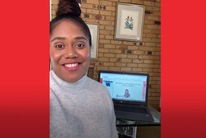 Griffith College student Paulina Taumalau Naisarani smiling at camera with laptop in the background