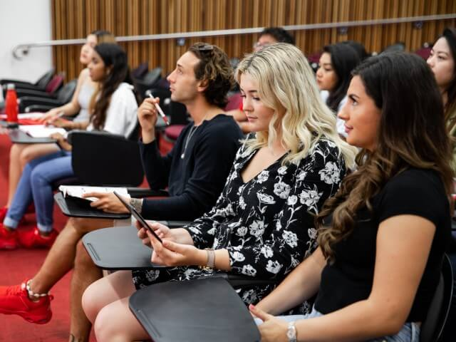 Griffith College students listening to lecture in lecture theatre